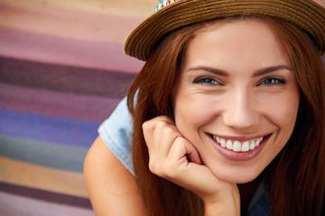 Woman smiling with wide brimmed hat l Cosmetic Dentistry Alafaya Florida