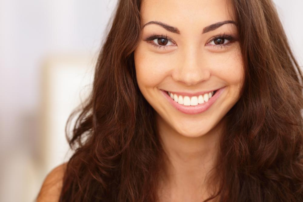 smiling young female I teeth whitening in orlando, fl
