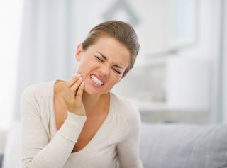 Woman Jaw Pain | Orlando Dentist