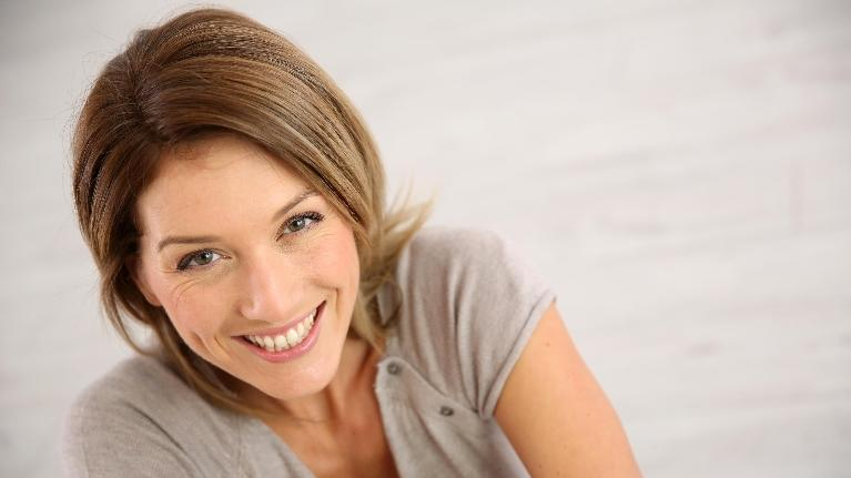 Dental Crowns in Orlando | Woman Smiling