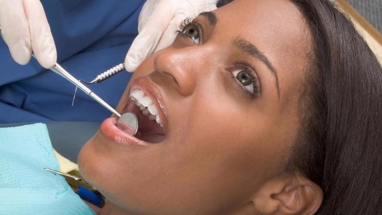 Woman Getting Dental Exam | Dental Cleanings in Orlando FL