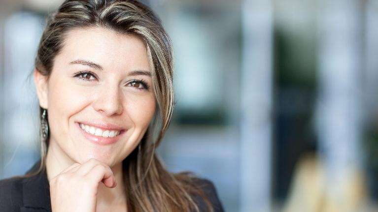 A businesswoman smiles | Orlando FL cosmetic dentist