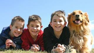 Kids with a Dog | Kid's Dentist in Orlando