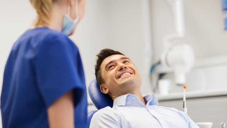 Dental Crowns in Orlando, FL | Man Getting Dental Cleaning